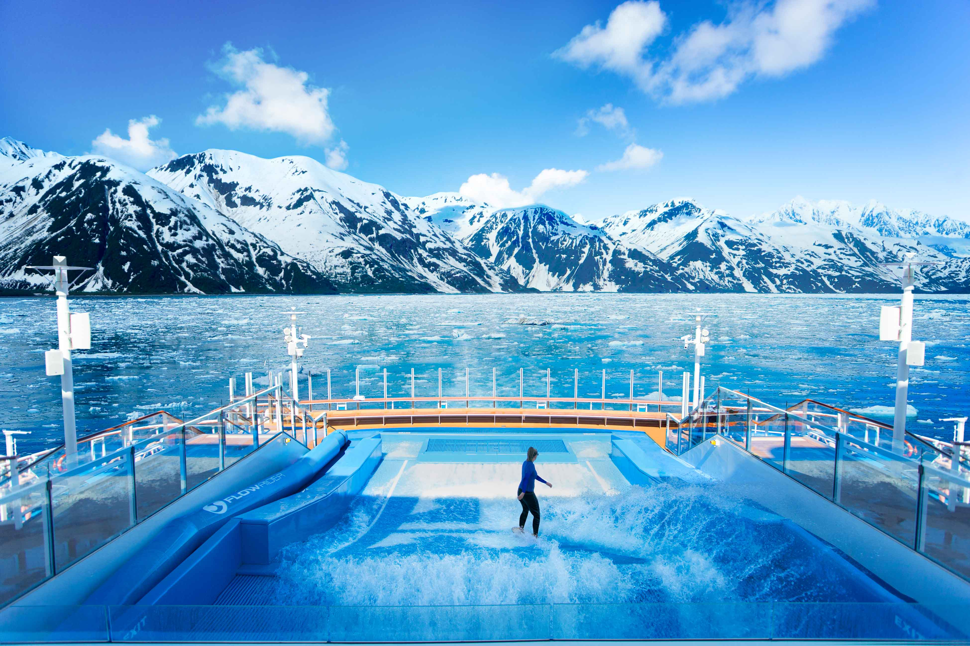 Flowrider in Ovation of the Seas with a stunning scenic view of Alaska.