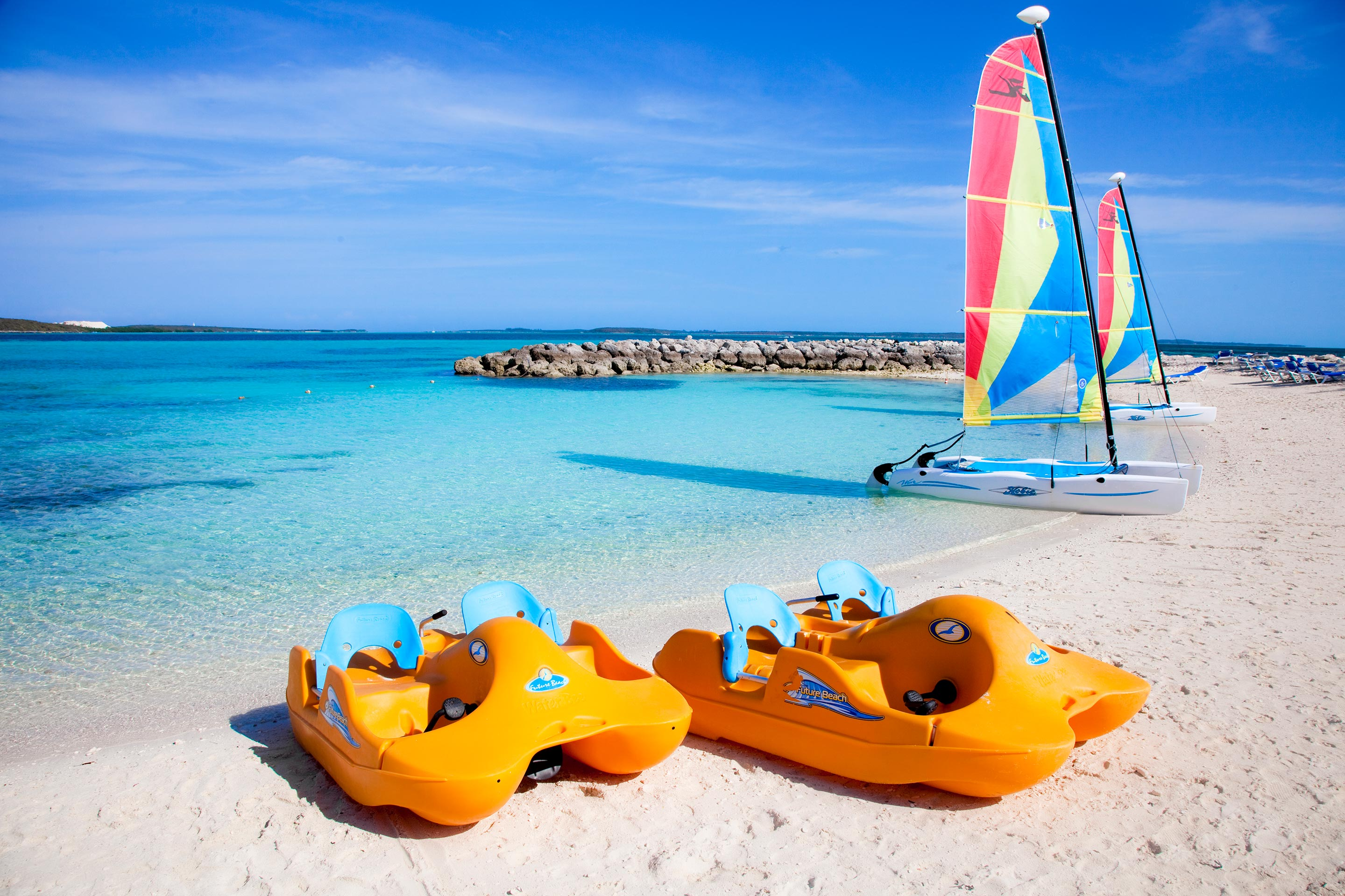 Two paddle boats on a beach in CocoCay, Bahamas