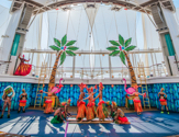 Performers dancing on stage during the Hideaway Heist Cruise Show by Royal Caribbean