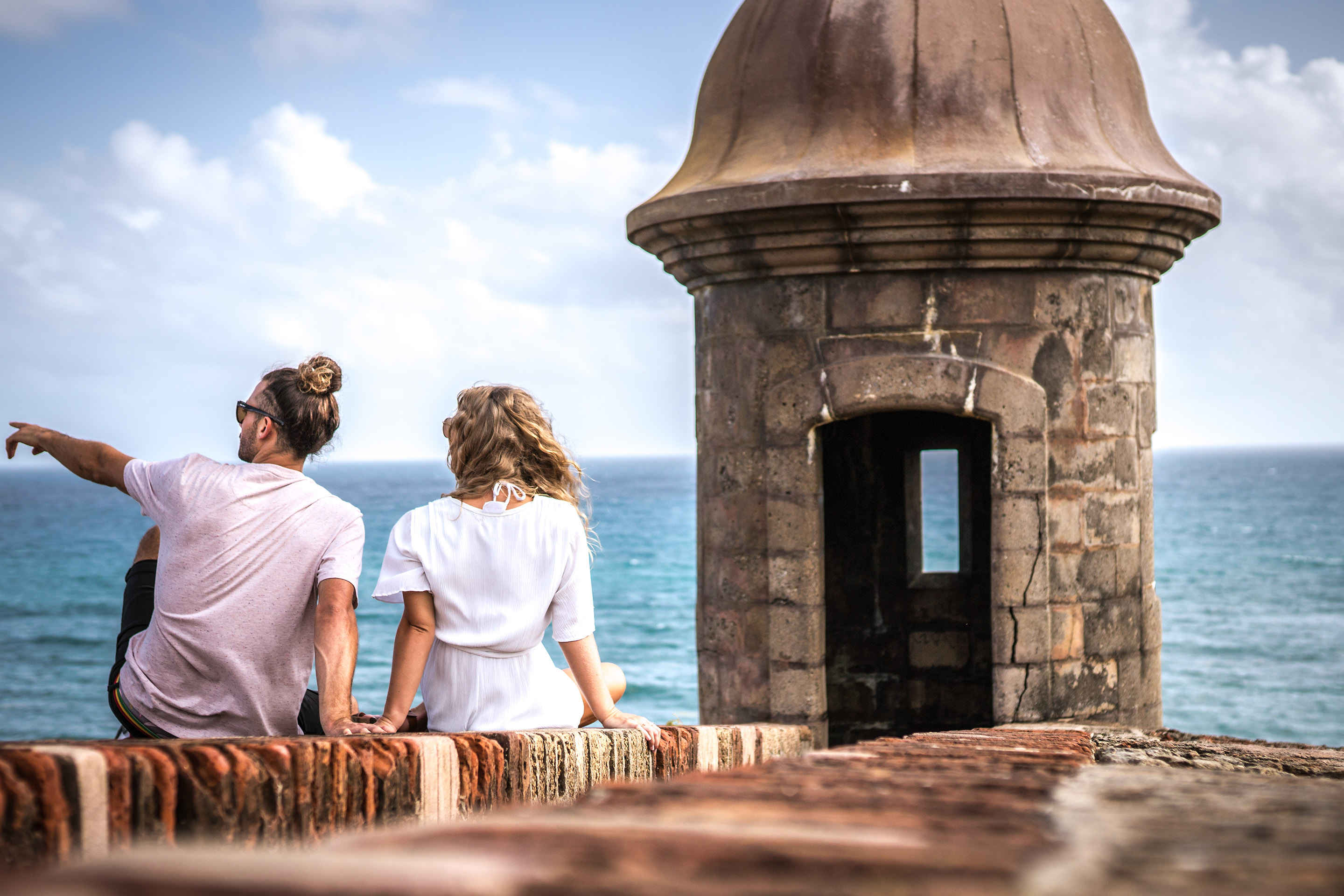 Couple taking in the view in the old city of San Juan, Puerto Rico