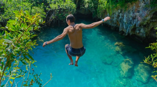 Man jumping into cenote in Mexico