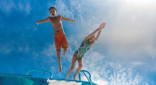Kids jumping in Cozumel on a summer cruise